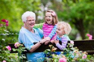 children visiting grandparents in assisted living